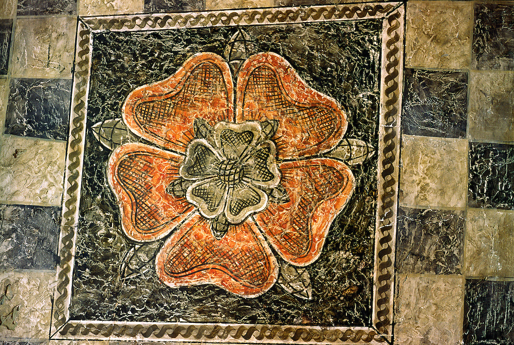 Haddon Hall mediaeval manor house, Derbyshire, England. Tudor period Tudor Rose motif painted on ceiling of the dining room.