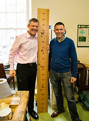 Pictured: Willie Rennie, was shown round the woodworking room by Senior manager Tommy Steel. Mr Rennie was keen to see if he measured up to the job as First Minister<br /> <br /> Scottish Liberal Democrat leader Willie Rennie met staff and customers at the Grassmarket caf&eacute;, part of the Grassmarket Community Project, as he visited the Edinburgh social enterprise today as part of his election campaign. He took the opportunity to set out Lib Dem student support plans ahead of an NUS election hustings in Glasgow. <br /> Ger Harley | EEm 11 April 2016