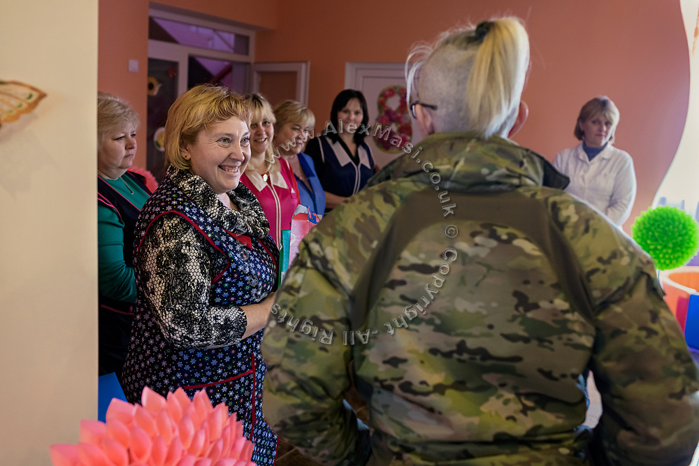 Julia Paevska is bringing presents and talking to teachers at a kindergarten in Myronivs'kyi, a small town near the frontline of eastern Ukraine.