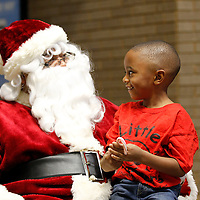 Thomas Wells | BUY at PHOTOS.DJOURNAL.COM<br /> Shannon Promary School student Bennett Moore III is all smiles as he tells Santa exactly what he wants for Christmas during a visit at Renasant Bank on Monday. Santa spent Monday and Tuesday getting Christmas list from area head start and primary school students at the bank.