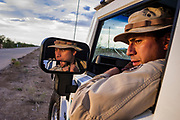 24 APRIL 2003 - SELLS, ARIZONA: A US Border Patrol agent on the Tohono O'Odham reservation south of Sells, AZ. The Tohono O'Odham reservation, which spans much of the southern Arizona border with Mexico, was a major crossing point for undocumented immigrants after urban entry points, like Nogales, AZ, and Douglas, AZ, were shut down.          PHOTO BY JACK KURTZ