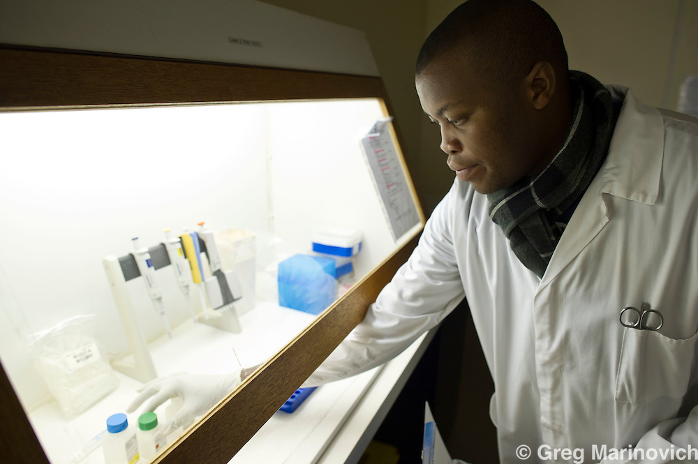 Witwatersand school of Medicine, June 27, 2011. Johannesburg, South Africa. Phd researcher Michelle Bronze and medical scientist Andrew Tlahadi at the Wits lab where testing is done. Photo Greg Marinovich
