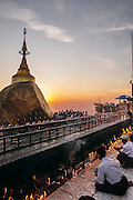 Devotees making offerings at Kyaiktiyo Pagoda (Golden rock)). Mon State, Myanmar