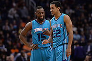 Jan 6, 2016; Phoenix, AZ, USA; Charlotte Hornets guard Brian Roberts (22) talks with teammate guard Kemba Walker (15) in the second half of the game against the Phoenix Suns at Talking Stick Resort Arena. The Phoenix Suns defeated the Charlotte Hornets 111-102. Mandatory Credit: Jennifer Stewart-USA TODAY Sports