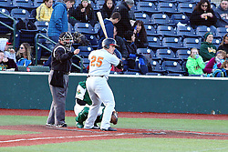 14 May 2016: home plate umpire restarts the game with Joe Staley batting during a Frontier League Baseball game between the Joliet Slammers and the Normal CornBelters at Corn Crib Stadium on the campus of Heartland Community College in Normal Illinois