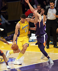 November 17, 2017 - Los Angeles, California, U.S - Suns Alex Len plays tough defense on Lakers Brook Lopez  during the contest as the host Los Angeles Lakers fall to  the visiting Phoenix Suns 122-113 on Friday, November 17,  2017 at the Staples Center in Los Angeles, California.  BURT  HARRIS/PI (Credit Image: © Prensa Internacional via ZUMA Wire)