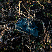 A military uniform lays among destroyed crops days after a battle near Petrovskiy.