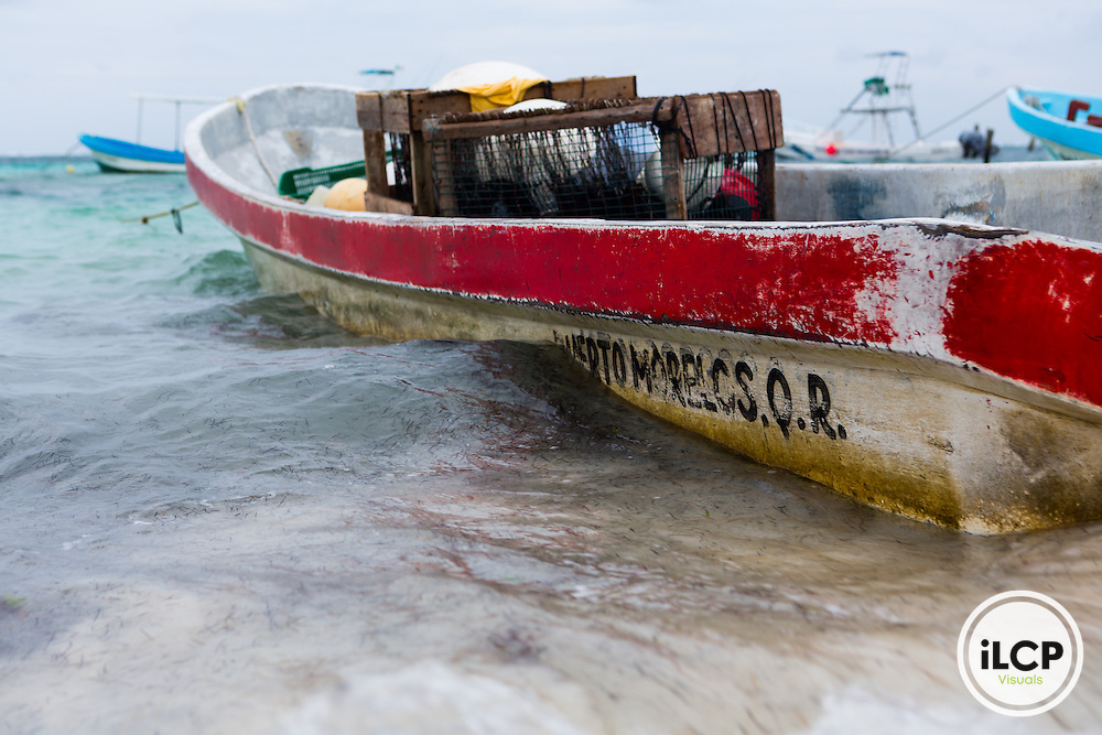 A fisherman's boat with crates for longline fishing in Puerto Morelos, Mexico. From a 2014 iLCP (International League of Conservation Photographers) expedition project documenting the people and places of the Mexican section of the Mesoamerican Reef (MAR).