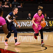 10 February 2018: The San Diego State Aztecs women's basketball team hosts Nevada on Play4Kay day at Viejas Arena.  San Diego State Aztecs guard Geena Gomez (20) brings the ball around the top of the key while being defended by Nevada Wolf Pack guard MorningRose Tobey (12) in the second half. The Aztecs beat the Wolfpack 75-72. <br /> More game action at www.sdsuaztecphotos.com