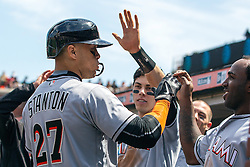 SAN FRANCISCO, CA - APRIL 24: Giancarlo Stanton #27 of the Miami Marlins is congratulated by teammates after hitting a home run against the San Francisco Giants during the fourth inning at AT&T Park on April 24, 2016 in San Francisco, California.  (Photo by Jason O. Watson/Getty Images) *** Local Caption *** Giancarlo Stanton