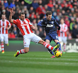 Manchester United's Juan Mata shot gets blocked by Stoke City's Erik Pieters - Photo mandatory by-line: Alex James/JMP - Tel: Mobile: 07966 386802 01/02/2014 - SPORT - FOOTBALL - Britannia Stadium - Stoke-On-Trent - Stoke v Manchester United - Barclays Premier League