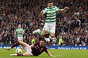 John Souttar of Hearts goes to ground to win the ball ahead of Tom Rogic of Celtic during the William Hill Scottish Cup Final match between Heart of Midlothian and Celtic at Hampden Park, Glasgow, United Kingdom on 25 May 2019.