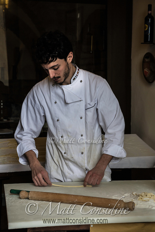 The picturesque hill town of Montepulciano in Tuscany has many restaurants and interesting shops offering local produce. I like this image because of the chiaroscuro effect and the timeless nature of the subject i.e. making pasta by hand. (Photo by Travel Photographer Matt Considine)