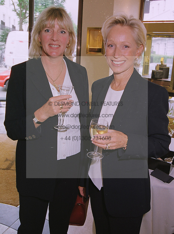 Left to right, the COUNTESS OF WESTMORLAND<br />  and MRS NIGEL HAVERS at a fashion show in <br /> London on 1st July 1999. MUA 35