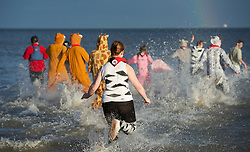 © Licensed to London News Pictures. 26/12/2012..Saltburn Beach, England..The annual Boxing Day dip takes place at the beach in Saltburn by the Sea in Cleveland, England. People attending the event take the plunge into the cold North sea to help raise money for various charity organisations...Photo credit : Ian Forsyth/LNP
