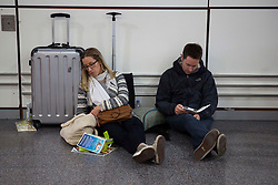 © Licensed to London News Pictures. 24/12/2013. Gatwick, UK Thousands of passengers were stuck at Gatwick today, 24 December 2013, as they battled to get home for Christmas after 105 flights to and from the airport were cancelled. EasyJet was forced to cancel 83 flights while British Airways had to axe 22 services yesterday because of power cuts following Monday night's storm. Photo credit : Alex Christofides/LNP