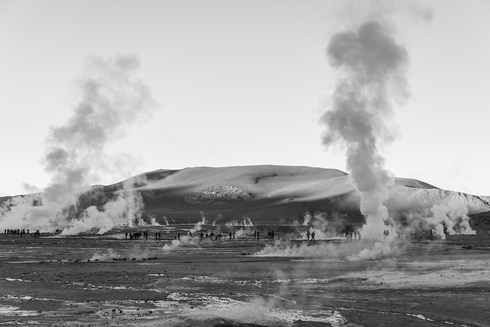 People walk between the fumaroles of the El Tatio geyser field, El Tatio, Chile.