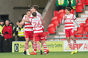 Doncaster celebrate as Tommy Rowe (10) scores 2-0 during the The FA Cup match between Doncaster Rovers and Scunthorpe United at the Keepmoat Stadium, Doncaster, England on 3 December 2017. Photo by Craig Zadoroznyj.