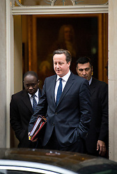 © London News Pictures. 21/11/2012. London, UK.  British Prime Minister David Cameron leaving Number 10 Downing street before Prime Minister Questions on November 21, 2012. Photo credit: Ben Cawthra/LNP