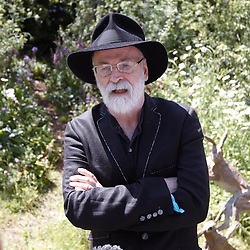 © licensed to London News Pictures. LONDON, UK  23/05/2011. Author Terry Pratchett with trademark hat at 2011 RHS Chelsea Flower Show. The show held each year in the grounds of the Royal Chelsea Hospital and organised by the Royal Horticultural society opens to the general public tomorrow and is already sold out. Please see special instructions for usage rates. Photo credit should read CLIFF HIDE/LNP