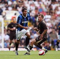Photo: Chris Ratcliffe.<br /> Tottenham Hotspur v Inter Milan. Pre Season Friendly. 28/07/2006.<br /> Teemu Tainio of Spurs (R) is beaten by Rodriguez Cesar of Inter Milan.
