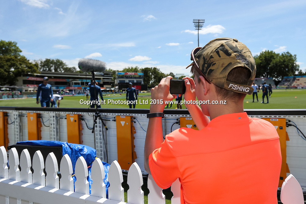A cricket fan takes a photo of the South African team as they go through their warm ups ahead of the ICC Cricket World Cup - South Africa v Zimbabwe at Seddon Park, Hamilton, New Zealand on Sunday 15 February 2015.  Photo:  Bruce Lim / www.photosport.conz