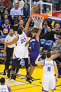 Golden State Warriors forward James Michael McAdoo (20) blocks a layup by Charlotte Hornets guard Ramon Sessions (7) at Oracle Arena in Oakland, Calif., on February 1, 2017. (Stan Olszewski/Special to S.F. Examiner)
