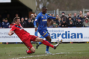 Dave Winfield of York City FC challenges Ade Azeez of AFC Wimbledon during the Sky Bet League 2 match between AFC Wimbledon and York City at the Cherry Red Records Stadium, Kingston, England on 19 March 2016. Photo by Stuart Butcher.
