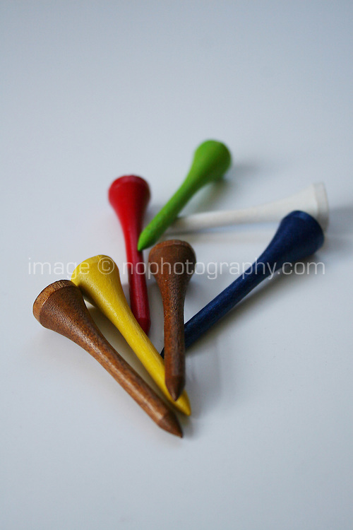 multicoloured wood golf tees