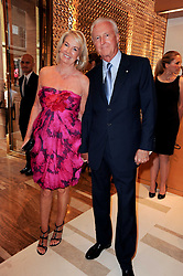 GALEN & HILARY WESTON at a party to celebrate the opening of the Louis Vuitton Bond Street Maison, New Bond Street, London on 25th May 2010.