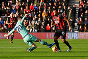Callum Wilson (13) of AFC Bournemouth is tackled by Shkodran Mustafi (20) of Arsenal during the Premier League match between Bournemouth and Arsenal at the Vitality Stadium, Bournemouth, England on 25 November 2018.