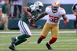 Sept 30, 2012; East Rutherford, NJ, USA; New York Jets wide receiver Jeremy Kerley (11) tries to avoid a tackle by San Francisco 49ers inside linebacker Patrick Willis (52) during the first half at MetLIfe Stadium.