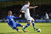 Gillingham defender Paul Konchesky (12) and Oldham Athletic defender Brian Wilson (4) during the EFL Sky Bet League 1 match between Gillingham and Oldham Athletic at the MEMS Priestfield Stadium, Gillingham, England on 8 October 2016. Photo by Martin Cole.