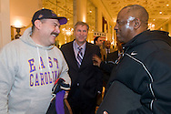 Jerry Leach, left, an ECU alumni who lives in Washington DC, welcomes Eastern Carolina University head coach Ruffin McNeill during a Military Bowl welcome reception on Dec. 24th for East Carolina University football team  at the Mayflower Hotel in Washington, DC. Steve Beck, Executive Director of the Military Bowl is at center. ECU will face the University of Maryland in the Military Bowl on December 29, 2010. (Photo by Alan Lessig)