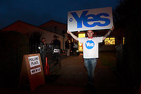 A supporter of Yes holding a banner outside of the St Gregory church hall where it takes place today as Polling place.<br /> 18th September 2014 polling vote for Scotland independence. Pako Mera/Universal News And Sport (Europe) 18/09/2014