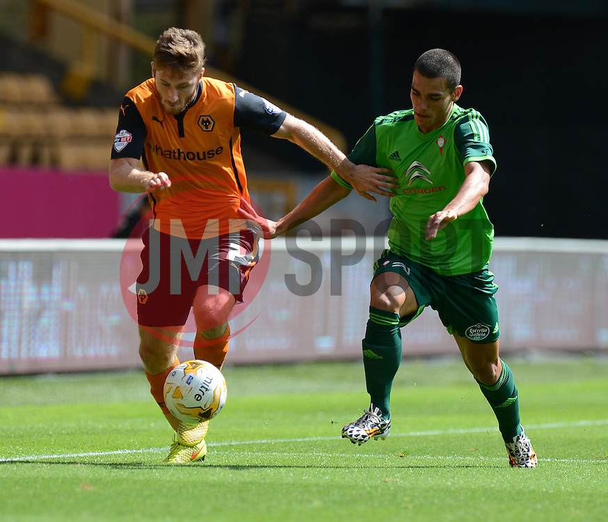 Wolverhampton's James Henry battles for the ball withCelta Vigo's Samu   - Photo mandatory by-line: Alex James/JMP - Tel: Mobile: 07966 386802 2/08/2014 - SPORT - FOOTBALL - Wolverhampton  - Molineux Stadium -   Wolverhampton vs  Celta Vigo - preseason
