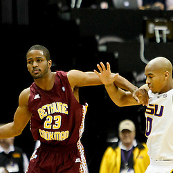 Jan 5, 2013; Baton Rouge, LA, USA; Bethune-Cookman Wildcats guard Brandon Stewart (23) is tied up with LSU Tigers guard Charles Carmouche (0) during the second half of a game at the Pete Maravich Assembly Center. LSU defeated Bethune-Cookman 79-63. Mandatory Credit: Derick E. Hingle-USA TODAY Sports