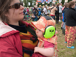 Ear defenders being worn by small child to protect them from loud noise at WOMAD 2009 music festival