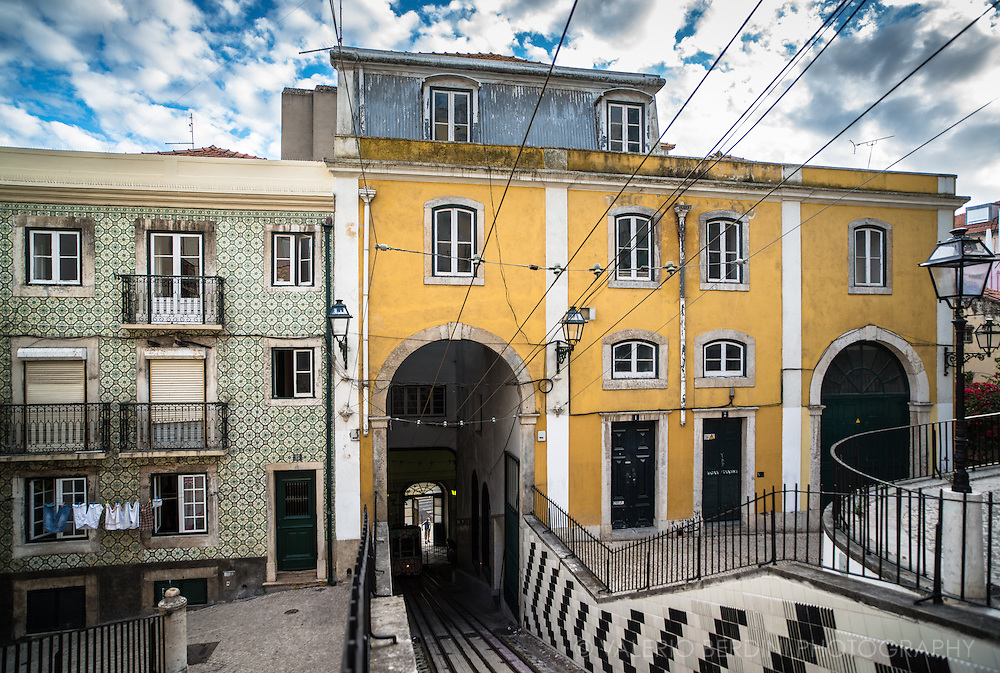 The Bica funicular climbs the Rua da Bica for 245 metres from the Rua S. Paulo, near Santos, to the Calhariz district. Its average gradient is 20% but is much steeper at the lower end (S.Paulo). This building conceals the bottom station.