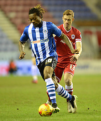 Wigan Athletic's Gaetan Bong competes with Cardiff City's Eoin Doyle - Photo mandatory by-line: Richard Martin-Roberts/JMP - Mobile: 07966 386802 - 24/02/2015 - SPORT - Football - Wigan - DW Stadium - Wigan Athletic v Cardiff City - Sky Bet Championship