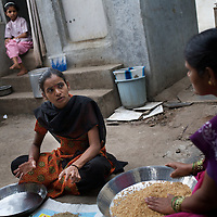 Vasanti with neighbours. HIV positive Vasanti Shinde, 26, works for the Save Foundation. One of her three daughters is also HIV positive.<br />