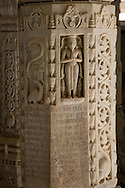 A pillar of intricately carved marble in the interior of the main Jain temple at Ranakpur, Rajasthan,<br /> India