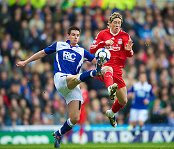 BIRMINGHAM, ENGLAND - Sunday, April 4, 2010: Liverpool's Fernando Torres and Birmingham City's Scott Dann during the Premiership match at St Andrews. (Photo by David Rawcliffe/Propaganda)