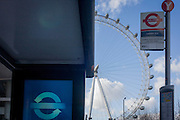 The theme of circles on a bus stop in Waterloo, with the presence of the giant London Eye tourist attraction towering above.
