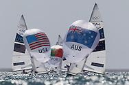 ENGLAND, Weymouth. 3rd August 2012. Olympic Games. Men's 470 Class. Mathew Belcher (AUS) Skipper, Malcolm Page (AUS) Crew and Stuart McNally (USA) Skipper, Graham Biehl (USA) Crew.