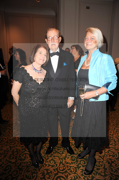 Left to right, VALERIE KLEEMAN, ALAN WHICKER and KATE ADIE at a gala dinner in celebration of 80 years since the first Foyles Literary Luncheon, held in The Ball Room, Grosvenor House Hotel, Park Lane, London on 21st October 2010.