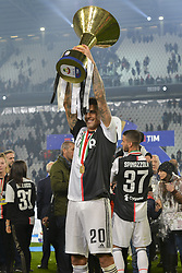 May 19, 2019 - Turin, Turin, Italy - Jo‹o Cancelo  of Juventus FC lints the trophy of Scudetto  2018-2019 at Allianz Stadium, Turin  (Credit Image: © Antonio Polia/Pacific Press via ZUMA Wire)