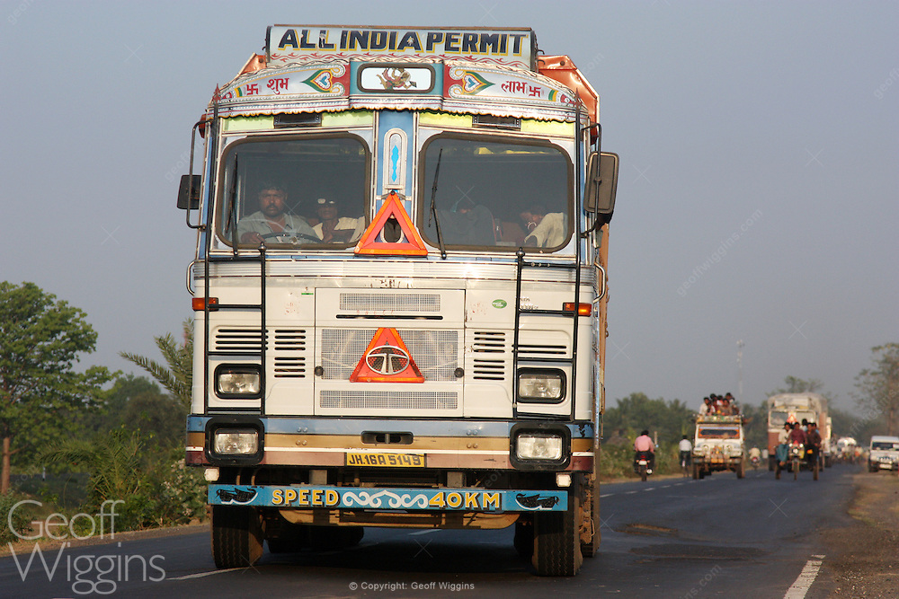 Indian Tata 3118C heavy truck traveling down West Bengal highway at sunset