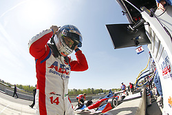 April 21, 2018 - Birmingham, Alabama, United States of America - TONY KANAAN (14) of Brazil gets suited up and strapped into his machine to take to the track for final practice for the Honda Grand Prix of Alabama at Barber Motorsports Park in Birmingham, Alabama. (Credit Image: © Justin R. Noe Asp Inc/ASP via ZUMA Wire)