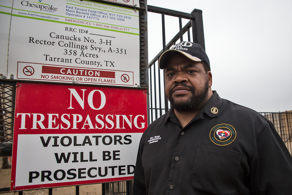 Pastor KyevTatum, an anti fracking and civil rights activist next to a fracking site in Fort Worth, Texas.